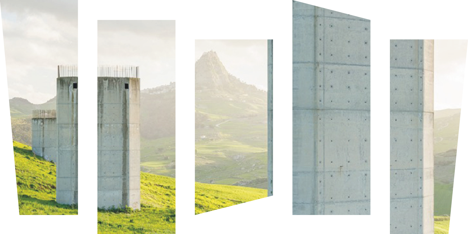 A view on unfinished architecture in the countryside with mountains on the horizon